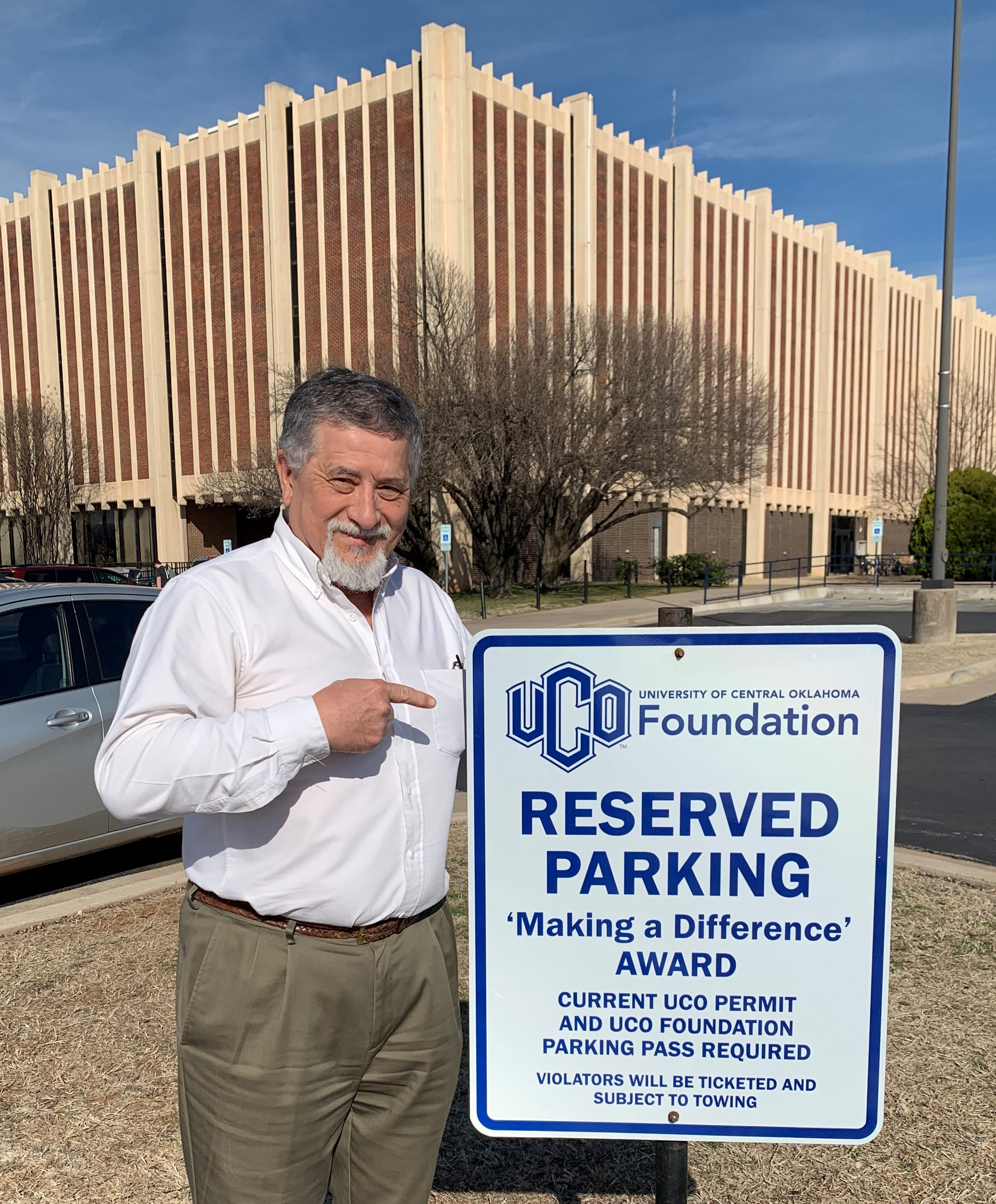 UCO employee Michael Calhoun stands by parking space